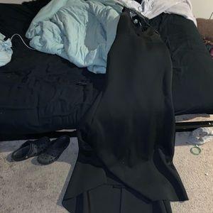 Medium long black bebe dress.